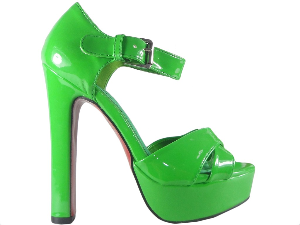 Green sandals on a shoe pole with ankle strap - 1