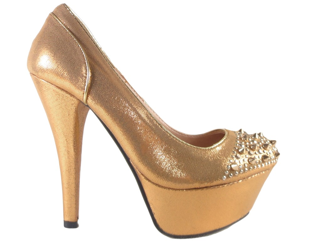 Shoes on a platform with spiked golden shuttles - 1