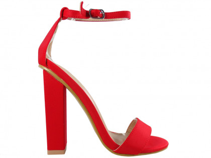 Red sandals on a pole with a diced belt - 1