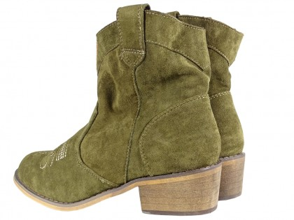 Black suede women's boots on a brick - 2