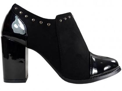 Black stiletto heeled boots with patent leather nose - 1
